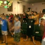 Kids love praising God while they sing at camp!